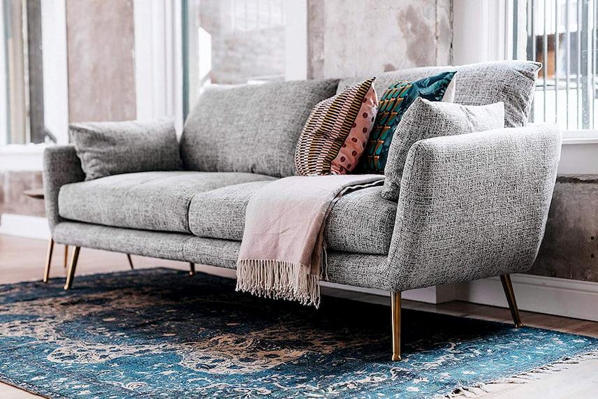 designer grey sofa with cushions