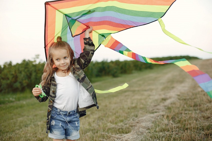 Kid-flying-a-kite-scaled