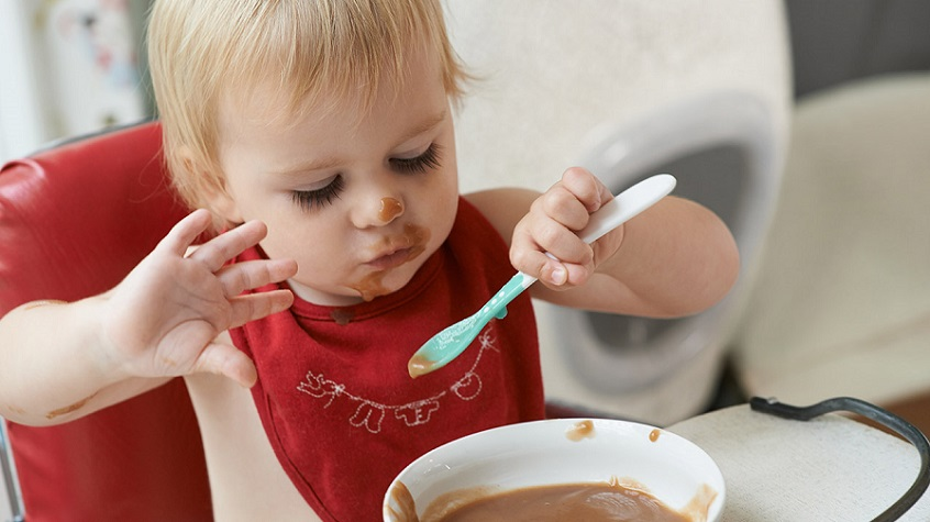Kid Eating From Baby Bowl