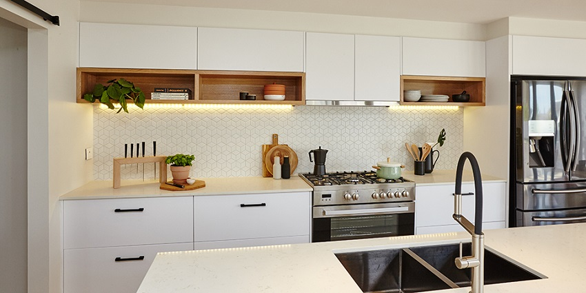 picture of modern kitchen with white flat pack cabinets and wood elements