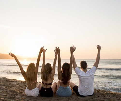 back-view-friends-holding-hands-up
