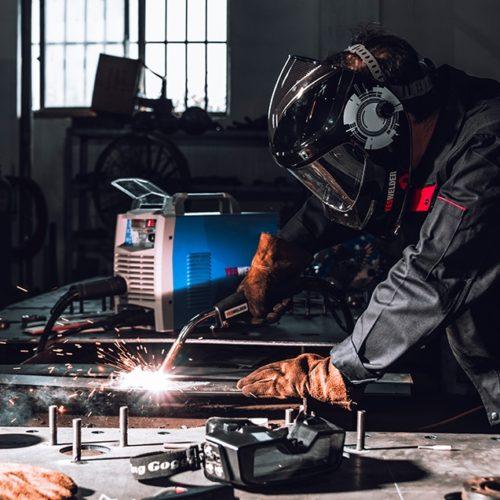welding solutions welder on workbench