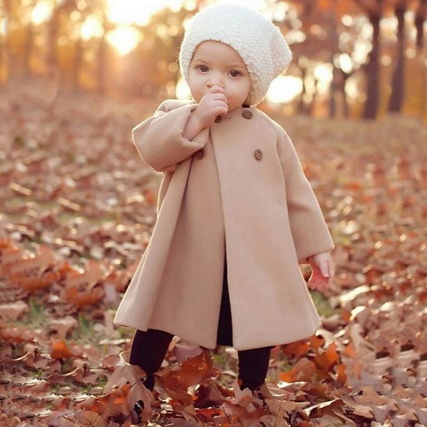 Baby girl in fancy coat