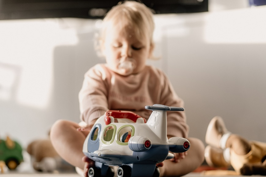 picture of a baby playing with toys